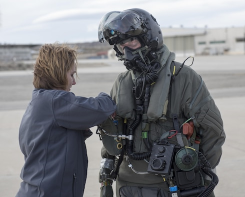 Marine Corps Maj. Douglas Rosenstock, 461st Flight Test Squadron, is inspected by contractor Dr. Angela Theys during a chemical/biological pilot ensemble test Jan. 6. (U.S. Air Force photo by Brad White)