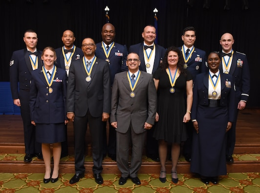 Annual award winners pose for a group photo during the 2016 Keesler Annual Awards Ceremony at the Bay Breeze Event Center Jan. 31, 2017, on Keesler Air Force Base, Miss. During the ceremony base leadership recognized outstanding Airmen and civilians from across the installation for their accomplishments throughout 2016. (U.S. Air Force photo by Kemberly Groue)