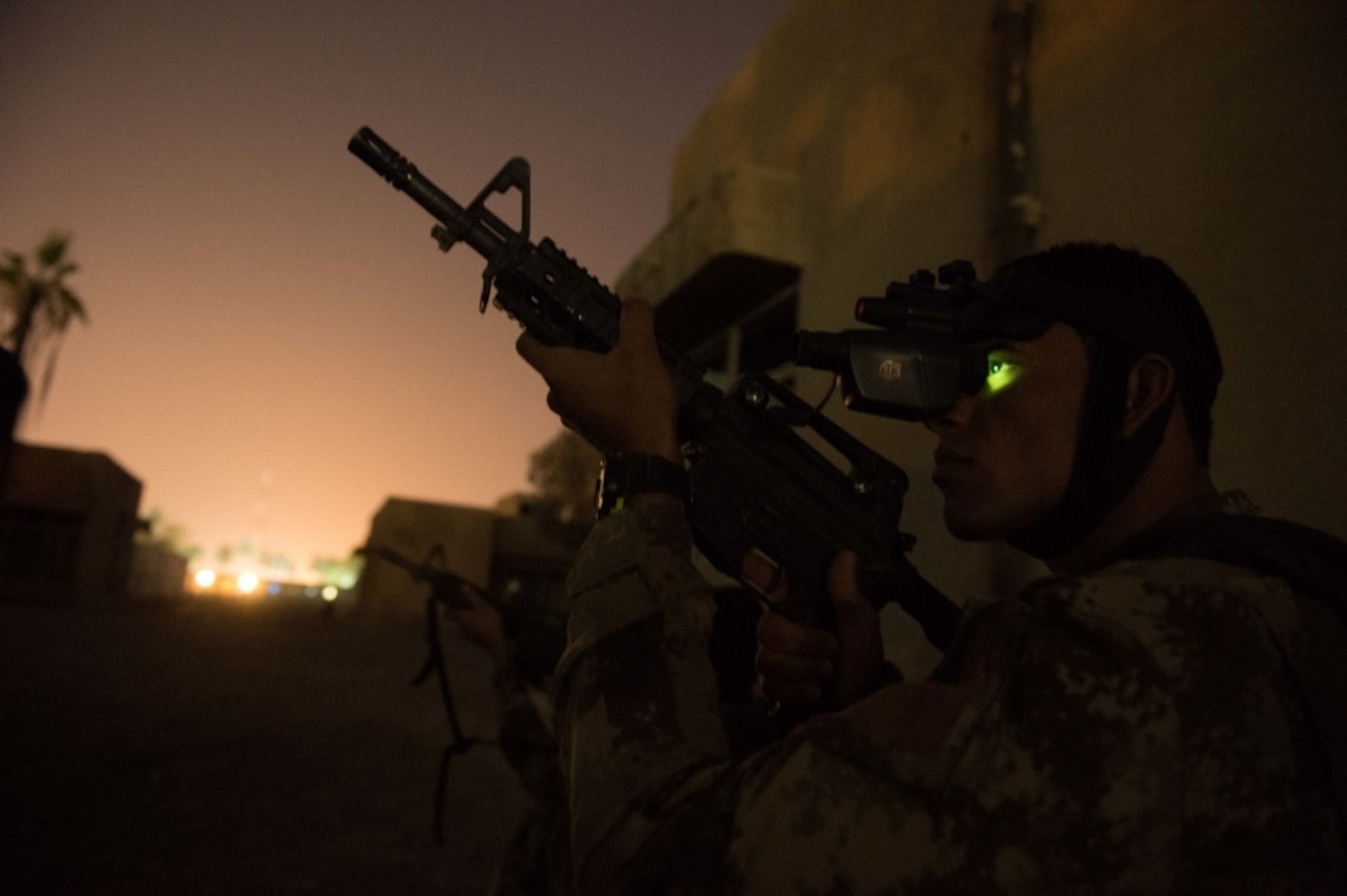 An Iraqi Counter-Terrorism Service soldier peers through night-vision goggles during an urban operation night exercise near Baghdad, Nov. 5, 2016. The CTS is Iraq's elite counter-terrorism force and has proven to be an effective fighting force against ISIL. Army photo by Staff Sgt. Alex Manne