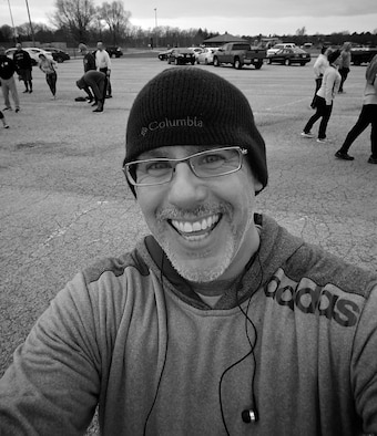"""Christopher Parr, 932nd Airlift Wing Public Affairs specialist, grabs a photo after completing week one of a running clinic, Jan. 26, 2017, Scott Air Force Base, Illinois. Members of Group 1 posted the faster times for the 1.5 mile pretest for the Scott Air Force Base Health Promotion Running Clinic.  """"This will be a challenge but we will all make some strides on our run times,"""" said Parr.  Photo links with a weekly commentary about the running clinic. (U.S. Air Force photo by Christopher Parr)"""