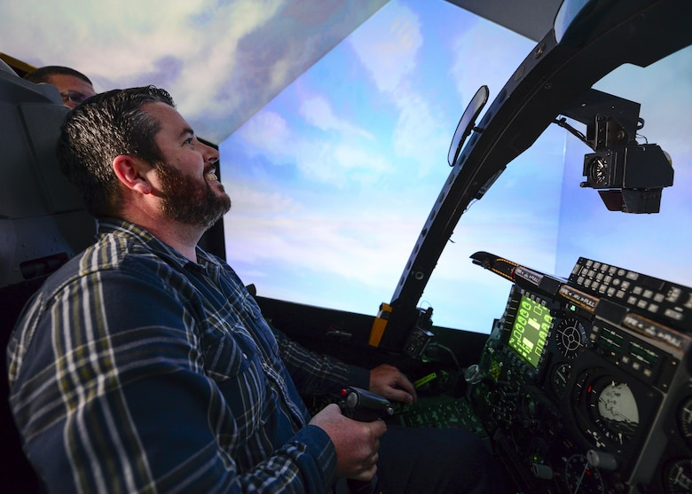 Marcus Foiles pilots an A-10 flight simulator during a tour at Davis-Monthan Air Force Base, Ariz., Jan. 27, 2017. Foiles was 10 years old in 1989 when he was granted a trip to D-M via the Make-A-Wish Foundation after being diagnosed with leukemia. Foiles made the trip back to D-M this past January and was able to pilot a flight simulator that was generations ahead of the one he flew in 1989. (U.S. Air Force photo by Airman 1st Class Nathan H. Barbour)