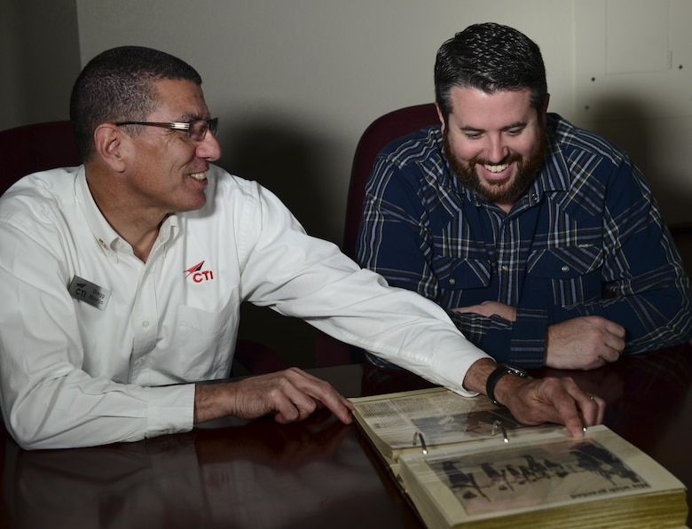 Retired U.S. Air Force Lt. Col. Gregg Montijo and Marcus Foiles look over a photo album at Davis-Monthan Air Force Base, Ariz., Jan. 27, 2017. Foiles was 10 years old in 1989 when he was granted a trip to D-M via the Make-A-Wish Foundation after being diagnosed with leukemia. Then he made the trip back to D-M this past January, bringing with him a photo album made by his mother from the original trip. (U.S. Air Force photo by Airman 1st Class Nathan H. Barbour)