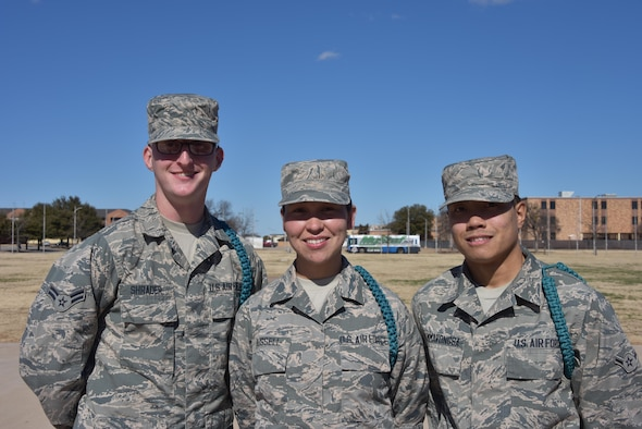 """(From left to right) Airman 1st Class Kevin Shrader, Airman Carol Russell, and Airman Richie Thammavonsa, noted as stand-out Airmen leaders, Teal Ropes,and Peer-to-Peer participants pose for a group photo at Sheppard Air Force Base, Texas. Every other Saturday these Airmen attend Peer-to-Peer to better develop themselves and those around them. """"We come to learn ways to positively influence people,"""" said Russell, an F-15 avionics student and mother of two. """"Then we go out and practice it among our peers, and they pick up on it. Then they practice it among their peers. As a whole, when we go to our different assignments, we get to continue this wherever we go."""" (U.S. AIr Force photo by 2nd Lt. Brittany Curry)"""