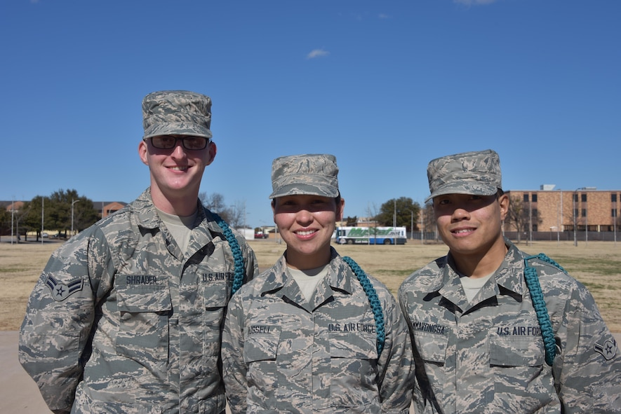 "(From left to right) Airman 1st Class Kevin Schrader, Airman Carol Russell, and Airman 1st Class Richie Thammavonsa, noted as stand-out Airmen leaders, Teal Ropes,and Peer-to-Peer participants pose for a group photo at Sheppard Air Force Base, Texas. Every other Saturday these Airmen attend Peer-to-Peer to better develop themselves and those around them. ""We come to learn ways to positively influence people,"" said Russell, an F-15 avionics student and mother of two. ""Then we go out and practice it among our peers, and they pick up on it. Then they practice it among their peers. As a whole, when we go to our different assignments, we get to continue this wherever we go."" (U.S. AIr Force photo by 2nd Lt. Brittany Curry)"