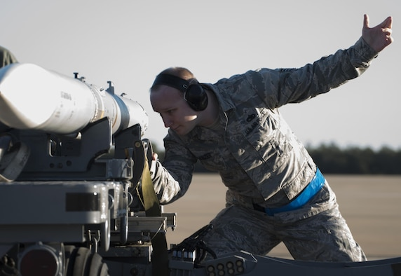 U.S. Air Force Staff Sgt. David Panzer, 33rd Aircraft Maintenance Squadron weapons load crew chief, secures a live AIM-120 advanced medium-range air-to-air missiles (AMRAAM)  onto a weapons jammer before loading it into an F-35A January 31, 2017, at Eglin Air Force Base, Florida. The 33rd Fighter Wing loaded and shot the first air-to-air missiles from an F-35A during a weapons system evaluation that took place at Tyndall Air Force Base later the same day. Carrying air-to-air missiles makes the F-35 a more versatile option for combatant commanders by securing the aircrafts survivability, in turn increasing likeliness of mission success.  (U.S. Air Force photo by Staff Sgt. Peter Thompson)