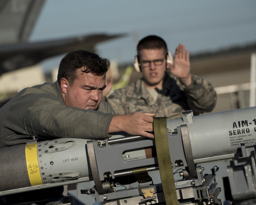 U.S. Air Force Staff Sgt. Brody Bundy, 33rd Aircraft Maintenance Squadron weapons load crew chief, left, and Senior Airman Blake Baker, 33 AMXS weapons load crewmember, secure a live AIM-120 advanced medium-range air-to-air missiles (AMRAAM)  onto a weapons jammer before loading it into an F-35A January 31, 2017, at Eglin Air Force Base, Florida. The 33rd Fighter Wing loaded and shot the first air-to-air missiles from an F-35A during a weapons system evaluation that took place at Tyndall Air Force Base later the same day. Carrying air-to-air missiles makes the F-35 a more versatile option for combatant commanders by securing the aircrafts survivability, in turn increasing likeliness of mission success.  (U.S. Air Force photo by Staff Sgt. Peter Thompson)