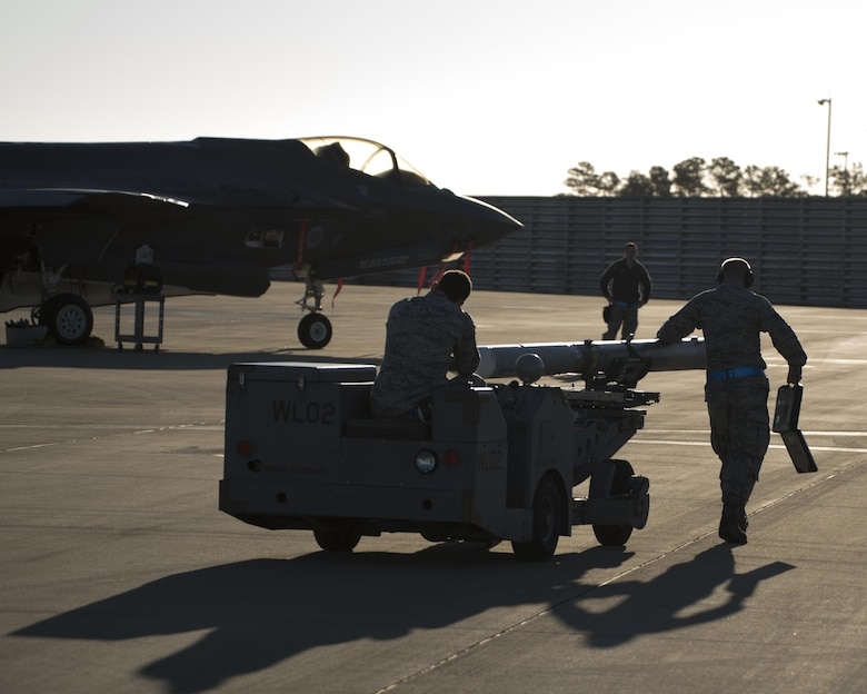 A U.S. Air Force weapons load crew assigned to the 33rd Aircraft Maintenance Squadron transports a live AIM-120 advanced medium-range air-to-air missiles (AMRAAM) before loading it into an F-35A January 31, 2017, at Eglin Air Force Base, Florida. The 33rd Fighter Wing loaded and shot the first air-to-air missiles from an F-35A during a weapons system evaluation that took place at Tyndall Air Force Base later the same day. Carrying air-to-air missiles makes the F-35 a more versatile option for combatant commanders by securing the aircrafts survivability, in turn increasing likeliness of mission success. (U.S. Air Force photo by Staff Sgt. Peter Thompson)