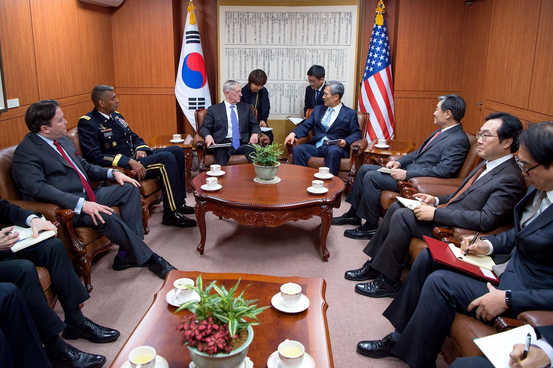 Defense Secretary Jim Mattis, center left, meets South Korea National Security Advisor Kim Kwan-jin.