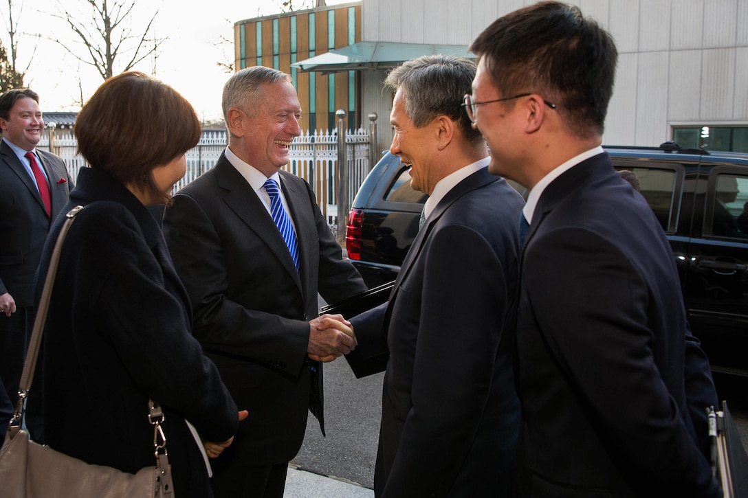 Defense Secretary Jim Mattis, center left, greets South Korea National Security Advisor, Kim Kwan-jin.
