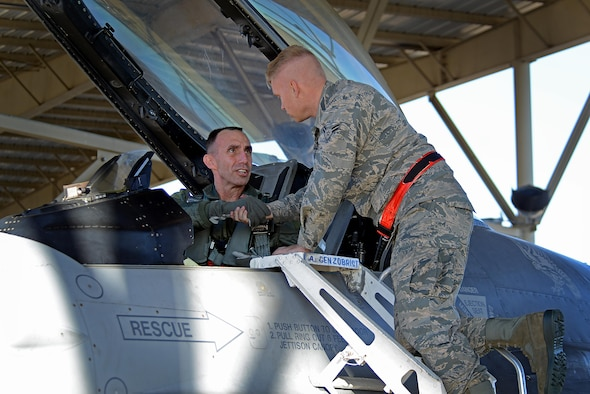 U.S. Air Force Maj. Gen. Scott Zobrist, 9th Air Force commander, shakes hands with Airman 1st Class Michael Gradecki, a 20th Aircraft Maintenance Squadron crew chief, as he prepares for takeoff at Shaw Air Force Base, S.C., Dec. 1, 2016. Zobrist assumed command of 9th Air Force in May 2016 and has held staff positions at the Air Staff, Air Combat Command and U.S. Forces Japan. (U.S. Air Force photo by Airman 1st Class Kelsey Tucker)