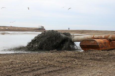 Dredged material is pumped into a containment facility located adjacent to Wilmington Harbor. The U.S. Army Corps of Engineers' Philadelphia District typically dredges the harbor every 9 to 12 months.