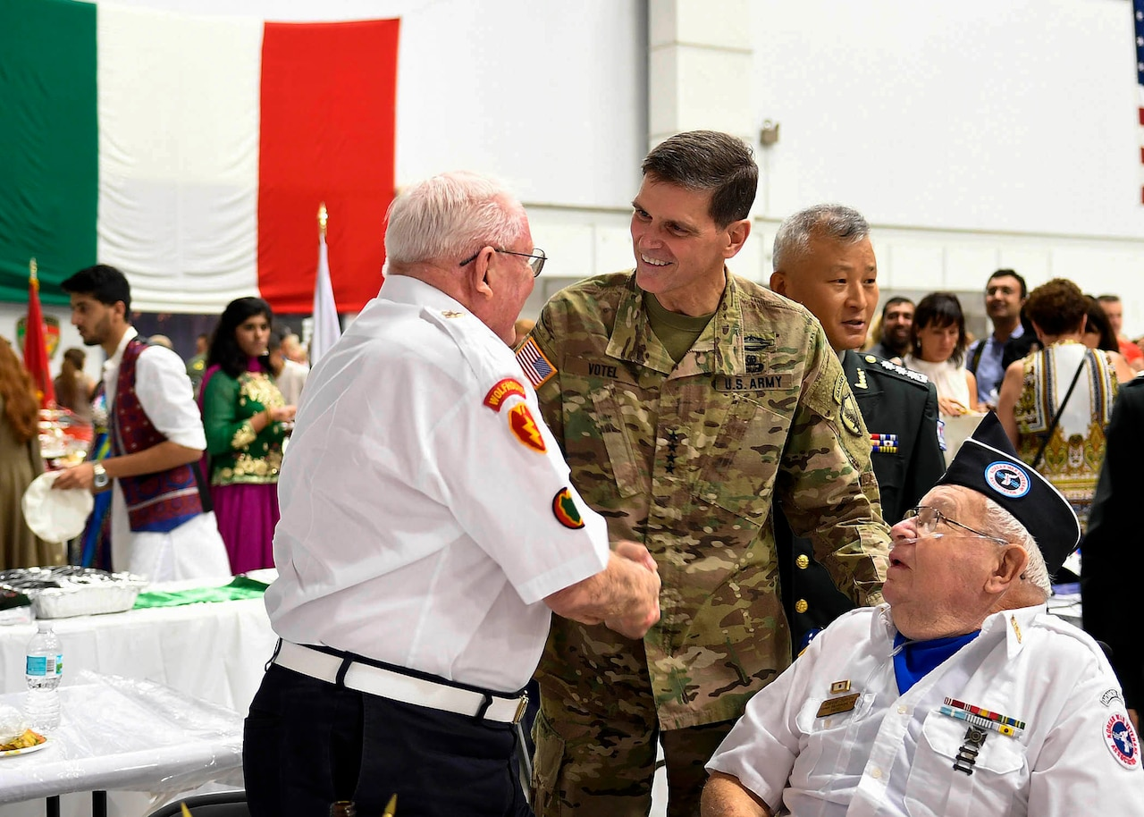 Army Gen. Joseph L. Votel, commander of U.S. Central Command, greets attendees at Coalition International Night at MacDill Air Force Base, Fla., Dec. 1, 2016. Air Force photo by Tech. Sgt. Dana Flamer