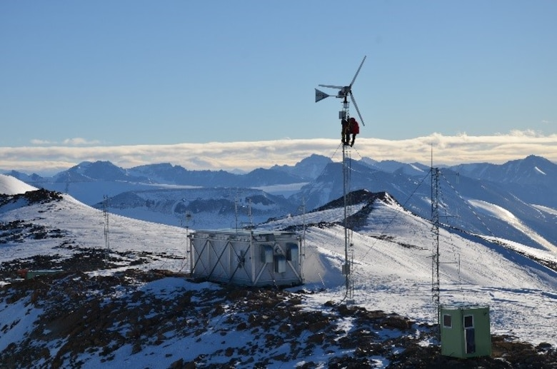 An Airman from the Air Force Technical Applications Center ascends to the top of a wind turbine at McMurdo Station, Antarctica, to inspect components used to power the seismic site.  This trip was part of AFTAC's annual maintenance requirement at its numerous seismic locations around the globe.  (U.S. Air Force photo)