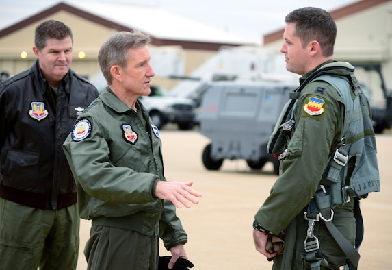 "Gen. Hawk Carlisle (center), commander of Air Combat Command, and Maj. Gen. Thomas Deale, ACC A3, congratulate Capt. John ""Rain"" Waters, on certifying as the pilot for the 2017-18 F-16 Viper demonstration team Feb. 1, 2017 at Langley Air Force Base, Va. Demonstration pilots, who perform at air shows worldwide, serve two-year tours on their respective teams, and must be certified at multiple levels. Carlisle, as COMACC, was Waters' final level of certification, and named him as a demo pilot immediatley after the flight. (U.S. Air Force photo by Emerald Ralston)"