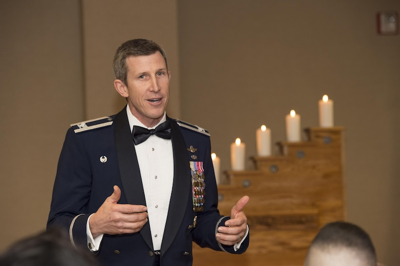 Col. Thomas Kunkel, 23d Wing commander, speaks to the audience during the Chief Induction Ceremony, Jan. 28, 2017, at Moody Air Force Base, Ga. The induction ceremony is a time-honored tradition that recognizes Airmen as they make the transition from senior master sergeant to chief master sergeant. (U.S. Air Force photo by Andrea Jenkins/Released)