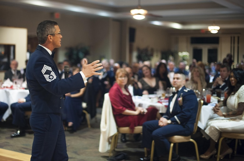 Chief Master Sgt. (ret.) Rick Parsons, former Air Combat Command command chief, speaks to the audience at the Chief Induction Ceremony, Jan. 28, 2017, at Moody Air Force Base, Ga. The induction ceremony is a time-honored tradition that recognizes Airmen as they make the transition from senior master sergeant to chief master sergeant. (U.S. Air Force photo by Andrea Jenkins/Released)