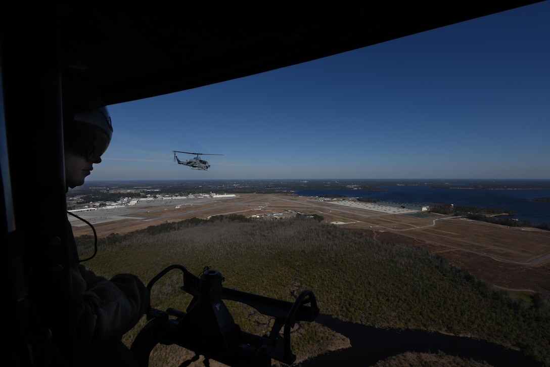 An AH-1W Super Cobra and UH-1Y Venom assigned to the Marine Light Aircraft Helicopter Squadron 269 from Marine Corps Air Station New River, in Jacksonville, North Carolina, respond to a simulated downed aircraft call during a tactical recovery of aircraft and personnel exercise, Jan. 31, 2017, in Kinston, North Carolina. The aircraft provided air support and successfully recovered the down aircrew during the exercise. (U.S. Air Force photo by Senior Airman Brittain Crolley)