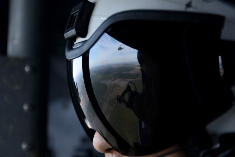 U.S. Marine Corps First Lt. Richard Leung, a UH-1Y crew member with the Marine Light Aircraft Helicopter Squadron 269 from Marine Corps Air Station New River, in Jacksonville, North Carolina, watches an AH-1W Super Cobra fly alongside him during a tactical recovery of aircraft and personnel exercise, Jan. 31, 2017, in Kinston, North Carolina. During the exercise, the crew was able to suppress enemy forces and extract the downed aircrew from hostile territory. (U.S. Air Force photo by Senior Airman Brittain Crolley)