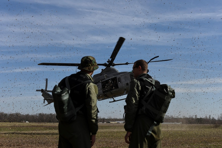 U.S. Air Force Capts. Cody Williams, 336th Fighter Squadron weapons systems officer, and Steve Keck, 336th FS pilot, are located by a rescue team in an AH-1W Super Cobra assigned to the Marine Light Aircraft Helicopter Squadron 269 from Marine Corps Air Station New River, in Jacksonville, North Carolina, during a tactical recovery of aircraft and personnel exercise, Jan. 31, 2017, in Kinston, North Carolina. Williams and Keck successfully evaded simulated enemy forces and coordinated rescue during the scenario. (U.S. Air Force photo by Airman Miranda A. Loera)