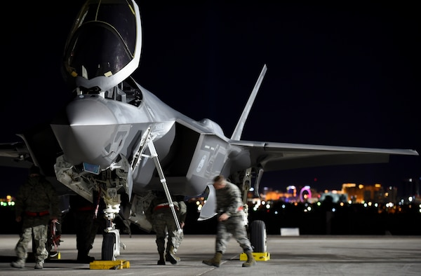 Maintainers from the 419th and 388th Fighter Wings conduct conducts preflight checks on an F-35A Lightning II from Hill Air Force Base, Utah, during Red Flag 17-1 at Nellis Air Force Base, Nev., Jan. 24, 2017. Airmen from the active duty 388th FW and Air Force Reserve 419th FW fly and maintain the Lightning II in a total force partnership, capitalizing on the strength of both components. (U.S. Air Force photo by Staff Sgt. Natasha Stannard)