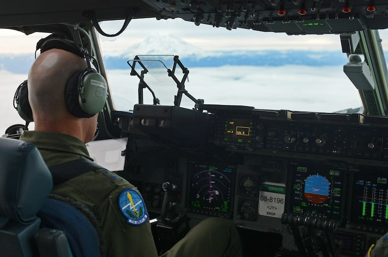 Gen. Carlton D. Everhart II, Air Mobility Command commander, flies a C-17 Globemaster III Jan. 30, 2017 during his visit to Joint Base Lewis-McChord, Wash. In addition to executing a C-17 training sortie, visiting Boeing, and talking with Airmen and Soldiers here, Everhart attended a civic leader dinner where he met with community partners. (U.S. Air Force photo by Senior Airman Divine Cox)