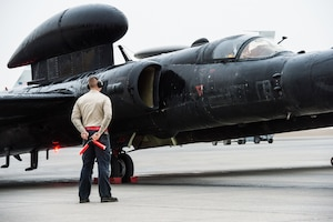 A 380 Expeditionary Aircraft Maintenance Squadron Airman prepares to assist a U-2 pilot in exiting the aircraft at an undisclosed location in Southwest Asia, Feb. 2, 2017. During this flight the airframe reached 30,000 flight hours. This is the second U-2 to reach this milestone out of the U-2 fleet. However, this achievement was the first while serving Air Force Central Command in an expeditionary environment. (U.S. Air Force photo/Senior Airman Tyler Woodward)