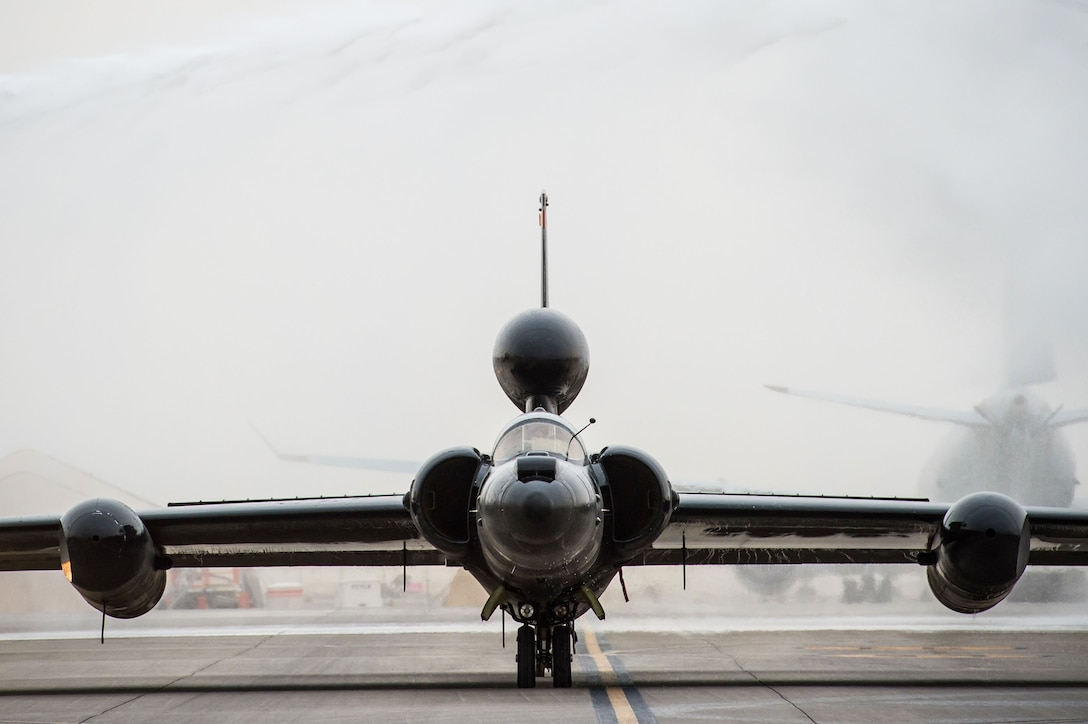 A U-2 taxis through a ceremonial shower after completing 30,000 flight hours at an undisclosed location in Southwest Asia, Feb. 2, 2017. Firetrucks parked on either side of the U-2 and discharged water for the ceremony. The milestone marks the second U-2 in the Air Force fleet to reach the historic milestone. (U.S. Air Force photo/Senior Airman Tyler Woodward)