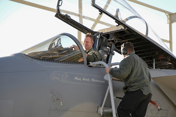 Maj. Cody Clark, 433rd Weapons Squadron F-15 pilot, is greeted by Airman 1st Class Thatcher Gore, 757th Aircraft Maintenance Squadron Eagle Maintenance Unit crew chief, after a sortie in which aircraft 83-3014 hit 10,000 flight hours at Nellis Air Force Base, Nev., Jan. 25, 2017. Although the Air Force's F-15 fleet is more than 30 years old, only a handful of the C/D/E aircraft are believed to be in the 10,000 hour club. (U.S. Air Force photo by Staff Sgt. Siuta B. Ika)
