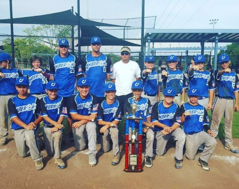 U.S. Air Force Staff Sgt. Patrick Bell, 33rd Operation Support Squadron aircrew flight equipment technician, second row third from left, poses with his travel team, June 2016. Bell was selected as the 2016 Coach of the Year for the Shalimar Little League he is a part of. Because of his skills in coaching, he was selected to coach the Shalimar All-Star team during the regional championship tournament.  (Courtesy Photo)
