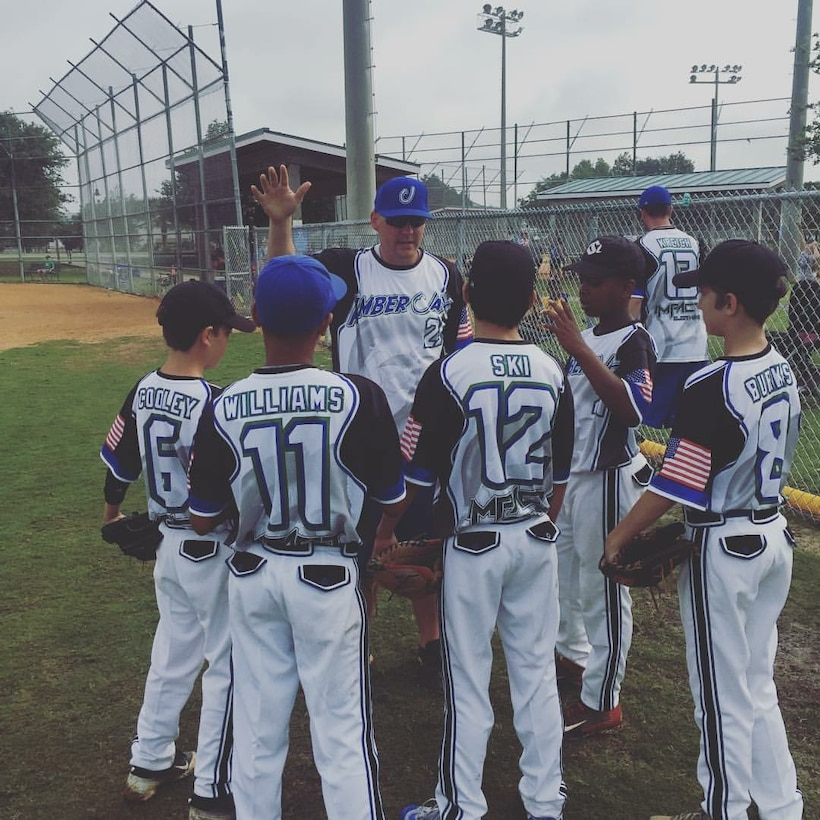 U.S. Air Force Staff Sgt. Patrick Bell, 33rd Operation Support Squadron aircrew flight equipment technician, speaks with players on a baseball team he coached, April 2016. Bell used his love of baseball to find balance between his life during and after duty hours. Because of his love of the sport of baseball, he has accepted a new coaching position for a Destin travel baseball team. (Courtesy Photo)