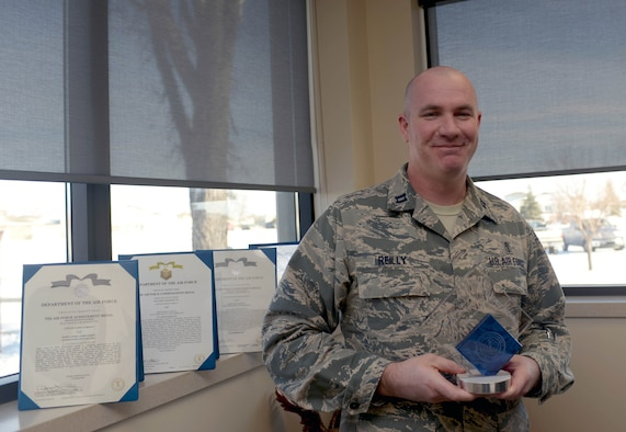 Capt. James Reilly, the bioenvironmental engineering flight commander assigned to the 28th Medical Group, holds the Military Health Leadership Excellence award for junior non-providers at Ellsworth Air Force Base, S.D., Jan. 26, 2017. The MHLE award is an annual award given to those who display great innovation in the medical field and is presented to the top junior providers and non-providers from each branch of the Department of Defense. (U.S. Air Force photo by Airman 1st Class Donald C. Knechtel)