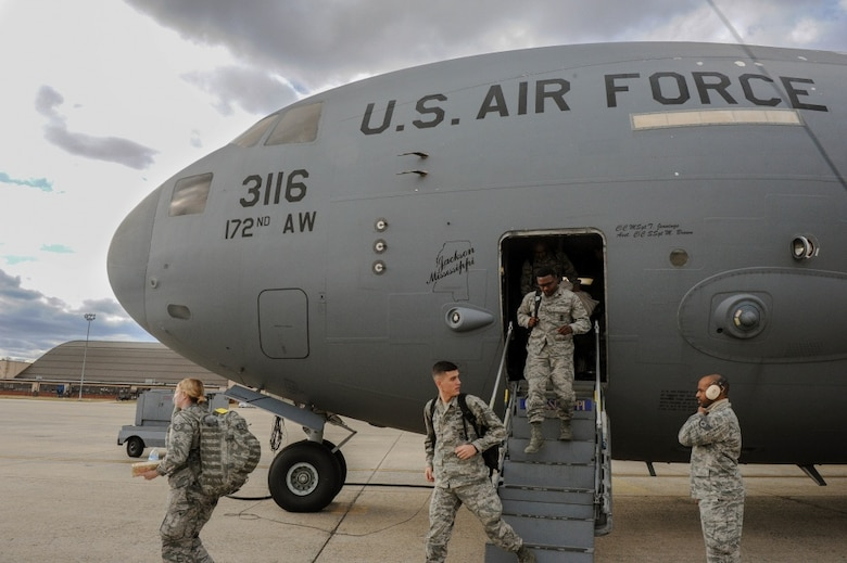 Members of the Mississippi Army National Guard, deplane a C-17 Globemaster III, at the Joint Base Andrews, Md., runway Jan. 18, 2017. The JRSOI welcomes and in-processes Airman and Soldiers who will support local authorities during the 58th Presidential Inauguration. More than 7,500 Guardsmen from 44 states, 3 territories (Guam, Puerto Rico & the U.S. Virgin Islands) and D.C. are providing critical functions for inaugural events. (U.S. Air National Guard photo by Senior Airman Anthony Small, JTF-DC)
