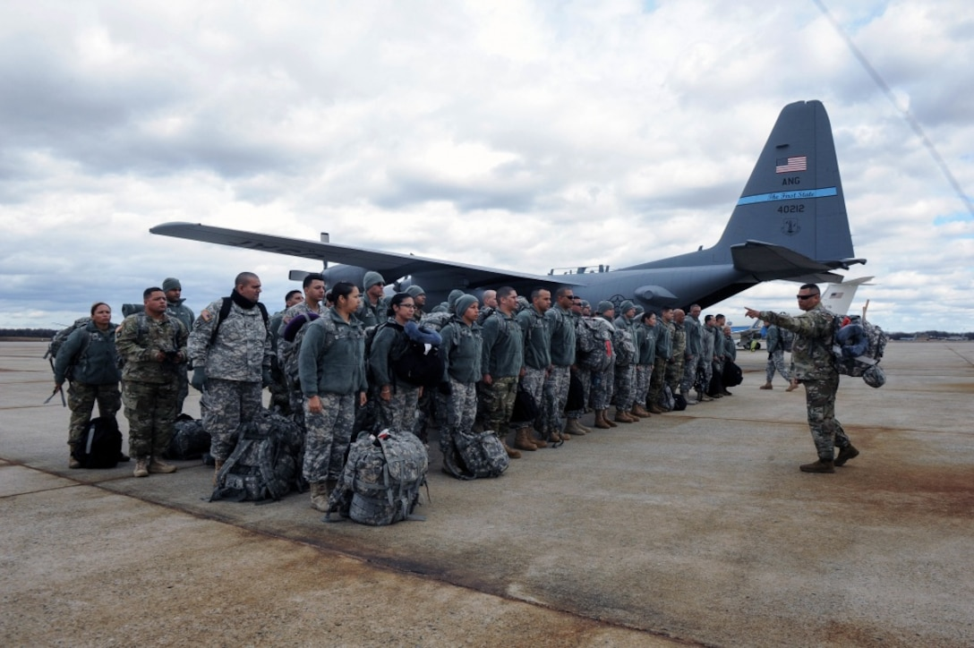 Members of the Puerto Rico Army National Guard, stands in formation before Joint Task Force-District of Columbia, Joint Reception Staging Onward Integration on Jan. 18, 2017. The JRSOI welcomes and in-processes Airman and Soldiers that arrive at Joint Base Andrews to support the 58th Presidential Inauguration. More than 7,500 Guardsmen from 44 states, 3 territories (Guam, Puerto Rico & the U.S. Virgin Islands) and D.C. are providing critical functions in support of the 58th Presidential Inauguration. (U.S. Air National Guard photo by Senior Airman Anthony Small, JTF-DC)