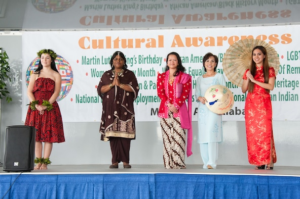 Cultural Awareness Day volunteers display traditional Asian American and Pacific Islander attire unique to their culture during the Cultural Awareness Day event, March 11, 2016, at Maxwell Air Force Base, Ala. Leaders from the 42nd Air Base Wing host the event annually to bring awareness and recognize various observances. This year's event is set to be held Feb. 10, 2017. (U.S. Air Force photo/Melanie Rodgers Cox)