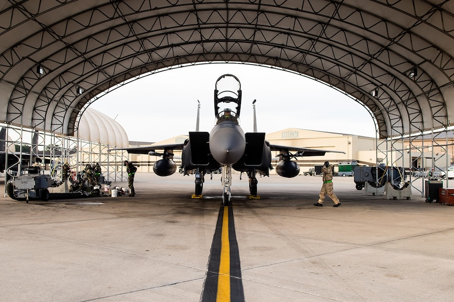Airmen from the 4th Aircraft Maintenance Squadron prepare to launch an F-15E Strike Eagle assigned to the 335th Fighter Squadron during exercise Coronet Warrior 17-01, Jan. 31, 2017, at Seymour Johnson Air Force Base, North Carolina. Airmen were evaluated on their ability to conduct operations while fending off simulated air and ground attacks with a potential threat of chemical or biological agents, causing changes to mission orientated protective posture gear. (U.S. Air Force photo by Airman Shawna L. Keyes)