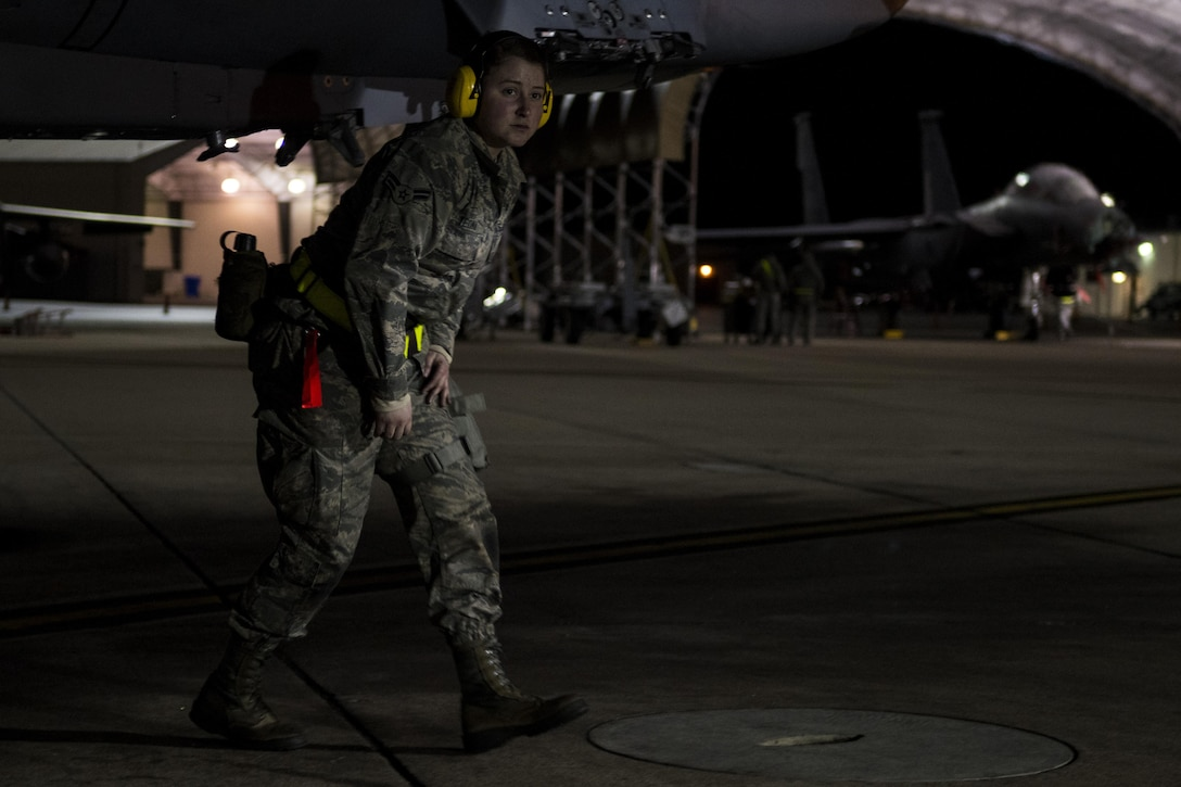 Airman 1st Class Melina Yeoman, 4th Aircraft Maintenance Squadron weapons load crew member, conducts a check on an F-15E Strike Eagle during exercise Coronet Warrior 17-01, Jan. 31, 2017, at Seymour Johnson Air Force Base, North Carolina. 24-hour operations were conducted during the exercise. (U.S. Air Force photo by Airman Shawna L. Keyes)