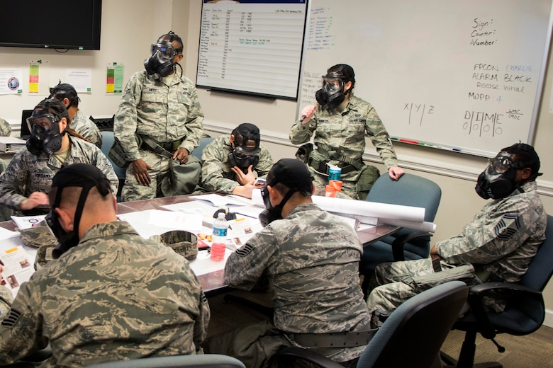 Airmen from the 4th Civil Engineer Squadron review Airman's Manuals for proper procedures concerning attacks during exercise Coronet Warrior 17-01, Jan. 30, 2017, at Seymour Johnson Air Force Base, North Carolina. The expeditionary exercise was conducted to keep Airmen's skills sharp for overseas contingency operations. (U.S. Air Force photo by Airman Shawna L. Keyes)