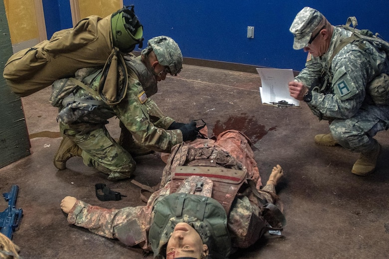 Army Reserve Sgt. First Class Fernando Terrazas, assigned to 2/364 Training Support Battalion, 5th Armored Brigade, applies a tourniquet on a casualty to stop the bleeding at the Medical Simulation Training Center during the First Army Division West Best Warrior Competition at Fort Bliss, Texas, Jan. 19, 2017. The winner of the First Army level Best Warrior Competition will have a chance to compete in the U.S. Army's Best Warrior Competition at Fort A.P. Hill, Virginia for the opportunity to be the Army's Best NCO and Soldier of the Year. (U.S. Army photo by Sgt. Matthew S. Griffith/Released)