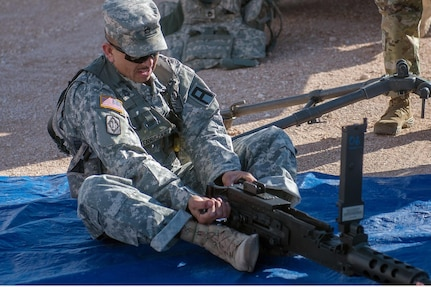 Army Reserve Sgt. First Class Fernando Terrazas, assigned to 2/364 Training Support Battalion, 5th Armored Brigade, assembles a M2 .50 Caliber machine gun during the Warrior Task and Battle Drill portion of the First Army Division West Best Warrior Competition at Fort Bliss, Texas, Jan. 20, 2017. The winner of the First Army level Best Warrior Competition will have a chance to compete in the U.S. Army's Best Warrior Competition at Fort A.P. Hill, Virginia for the opportunity to be the Army's Best NCO and Soldier of the Year. (U.S. Army photo by Sgt. Matthew S. Griffith/Released)