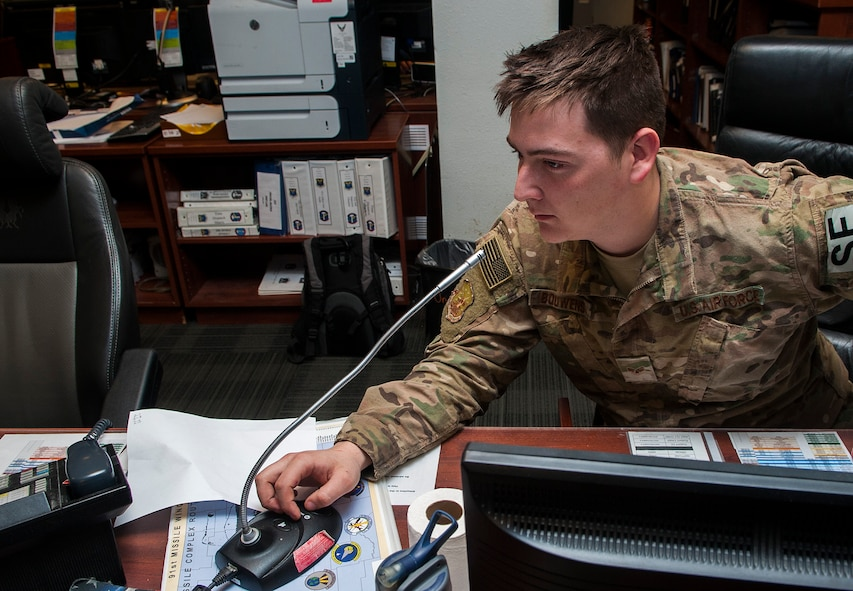 Senior Airman Caleb Bouwens, 91st Missile Security Forces Squadron transportation control functions controller, tracks road updates for government vehicles at Minot Air Force Base, N.D., Jan. 24, 2017. Airmen in the 91st Missile Maintenance Operations Center continuously keep track of all government vehicles at the missile field sites. (U.S. Air Force photo/Airman 1st Class Jonathan McElderry)