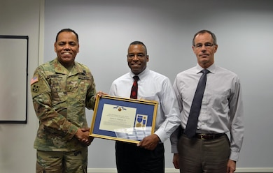 The U.S. Army Corps of Engineers (USACE), South Atlantic Division Commander Brig. Gen. C. David Turner, James E. Hathorn Jr., USACE Mobile Water Management Chief, and Pete Taylor, USACE Mobile Deputy for Programs and Project Management (left to right), pose for a photo shortly after Turner presented Hathorn with the Meritorious Civilian Service Award Jan. 30 in Mobile, Ala. The award is the second highest honor a U.S. civilian is eligible to receive.