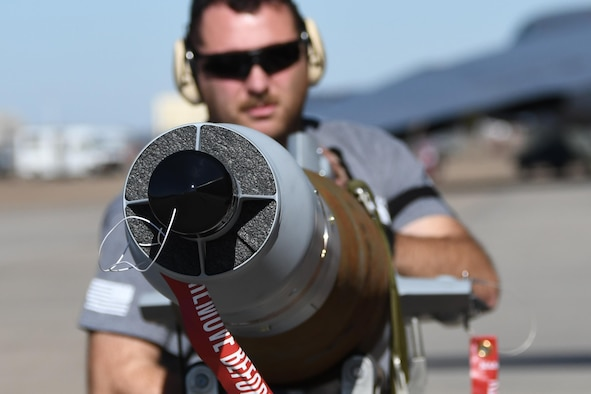 Tech. Sgt. Matt Gerrits, 307th Aircraft Maintenance Squadron armament systems specialist, prepares to load a guided bomb unit-12, at Barksdale Air Force Base, La., Feb. 1, 2017. The GBU-12 utilizes a Mk82 500-pound general purpose warhead with a computer control group at the front end and an airfoil group at the back. When a target is illuminated by a laser, either airborne or ground-based, the guidance fins react to signals from the control group and steer the weapon to the target. Wings on the airfoil group add the lift and aerodynamic stability necessary for in-flight maneuvering.  It was loaded in conjunction with other kinds of bombs on the Conventional Rotary Launcher.  The new launcher is capable of carrying several different types of munitions at one time.  The CRL was being prepped to undergo its first live-fire training mission. (U.S. Air Force photo by Tech. Sgt. Ted Daigle/released)