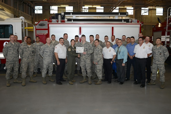 "Airman 1st Class James Nicholson III, 47th Civil Engineer Squadron fire protection apprentice (front center), accepts the ""XLer of the Week"" award from Col. Michelle Pryor, 47th Flying Training Wing vice commander (front left), and Chief Master Sgt. George Richey, 47th FTW command chief (front right), on Laughlin Air Force Base, Texas, Jan. 25, 2017. The XLer is a weekly award chosen by wing leadership and is presented to those who consistently make outstanding contributions to their unit and Laughlin. (U.S. Air Force photo/Airman 1st Class Benjamin N. Valmoja)"
