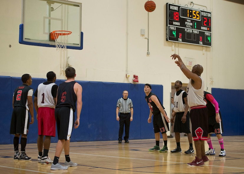 David Carter, Maintenance Group power forward, shoots a free throw during the first half of the Intramural Basketball Championship game, Jan. 30, at Mountain Home Air Force Base, Idaho. MXG beat the Civil Engineer 51-42. Carter was his team's second leading scorer with 13 points.