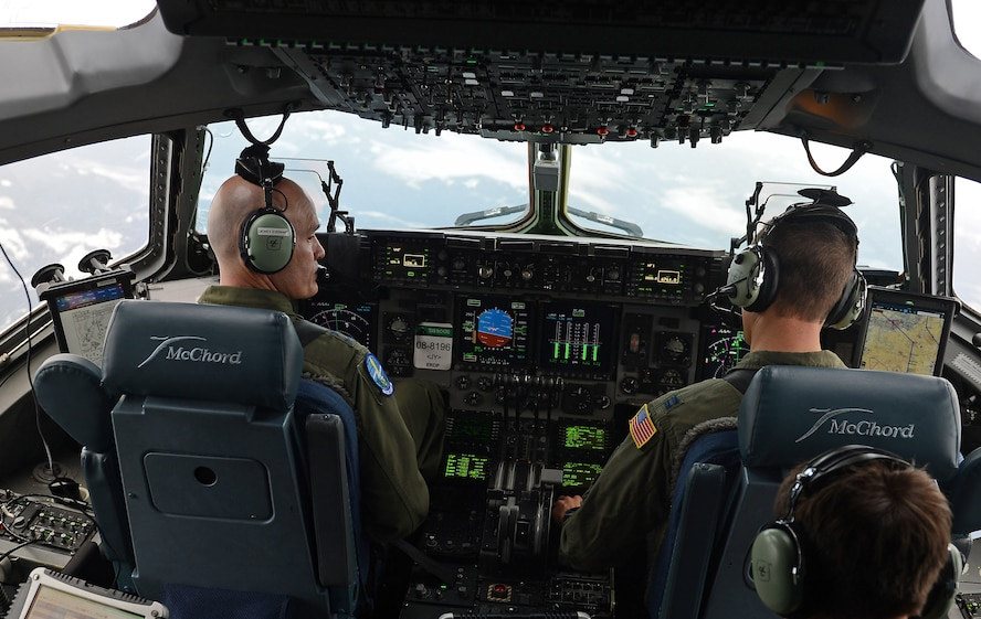 Gen. Carlton D. Everhart II (top left), Air Mobility Command commander, flies a C-17 Globemaster III aircraft with pilots from the 62nd Airlift Wing, Jan. 30, 2017 during his visit to Joint Base Lewis-McChord, Wash. In addition to flying the C-17, visiting Boeing, and talking with Airmen and Soldiers here, Everhart attended a civic leader dinner where he met with community partners. (U.S. Air Force photo by Senior Airman Divine Cox)