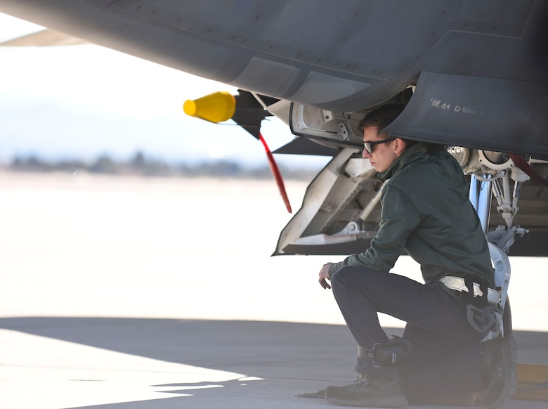 U.S. Air Force Airman 1st Class Brian Dowling, 27th Aircraft Maintenance Unit crew chief, conducts preflight checks on an F-22 Raptor during Red Flag 17-1 at Nellis Air Force Base, Nev., Jan. 26, 2017. Preflight checks are conducted to ensure aircraft are safe to fly in the large force, coalition exercise. (U.S. Air Force photo by Staff Sgt. Natasha Stannard)