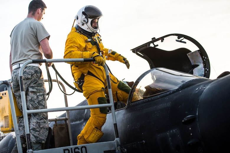 U-2 pilot Maj. Ryan enters into a cockpit before flying a sortie in support of Combined Joint Task Force-Operation Inherent Resolve at an undisclosed location in Southwest Asia, Feb. 2, 2017. During the sortie, the aircraft completed 30,000 hours of flight. This marked the second U-2 in the USAF fleet to reach the milestone and the first overall while flying expeditionary missions under Air Force Central Command. (U.S. Air Force photo/Senior Airman Tyler Woodward)