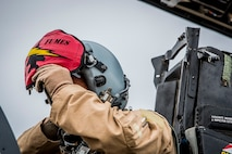 U. S. Air Force Col. David Brynteson, 332nd Expeditionary Operations Group commander, dons his helmet Jan. 27, 2016, in Southwest Asia. Brynteson was preparing to fly his last sortie in theater. (U.S. Air Force photo by Staff Sgt. Eboni Reams)