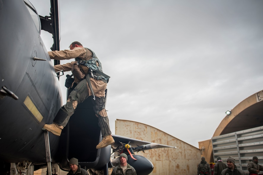 U. S. Air Force Col. David Brynteson, 332nd Expeditionary Operations Group commander, debarks his aircraft after his fini flight, Jan. 27, 2016, in Southwest Asia. Brynteson has been commanding here for four months leading combat operations in the area of responsibility. (U.S. Air Force photo by Staff Sgt. Eboni Reams)