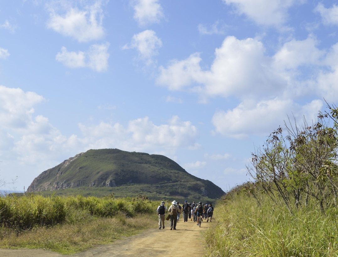 U.S. Air Force Airmen from Kadena Air Base, Japan, walk along a trail to Mount Suribachi, Iwo Jima, Jan. 12, 2017. Airmen from different units throughout Kadena were selected for this special trip as part of a professional military education outing to learn about the battle of Iwo Jima. (U.S. Air Force photo by Senior Airman Lynette M. Rolen/Released)